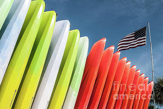 Kayaks with Flag by John Greco