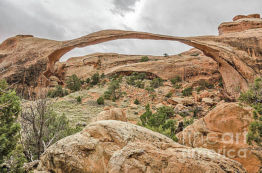 Landscape Arch Against a Cloudy Sky by Sue Smith
