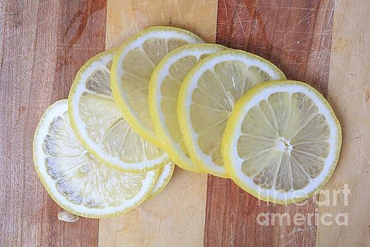 Edward Fielding - Lemon Slices On Cutting Board