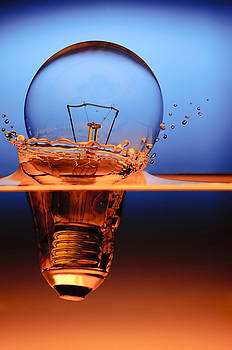 Light Bulb And Splash Water by Setsiri Silapasuwanchai