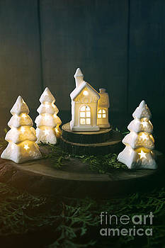 Sandra Cunningham - Little ceramic houses with lights and cedar branches