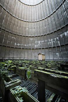 Little house inside industrial cooling tower by Dirk Ercken