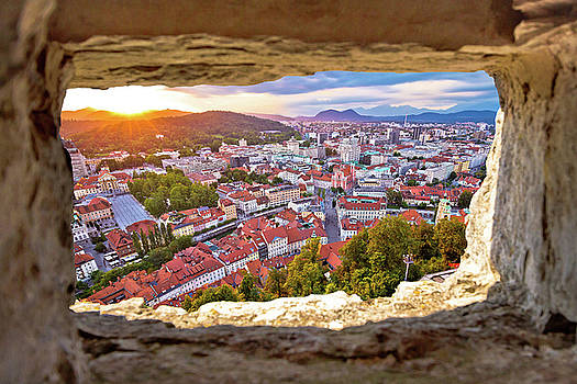 Ljubljana sunset through stone window aerial view by Dalibor Brlek