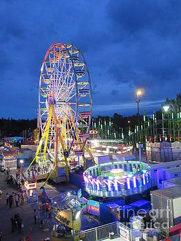 Looking Down on the Midway Rides at Night by John Malone