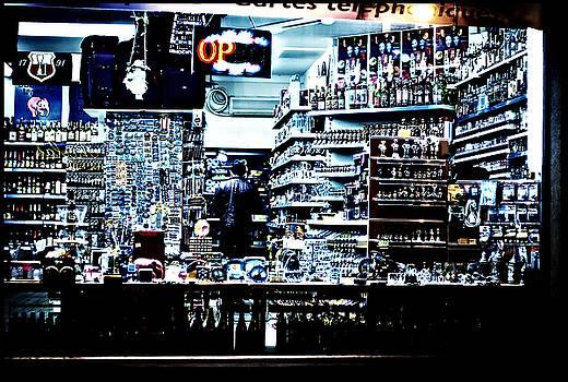 Man at liquor store by Tina Zaknic - Xignich Photography