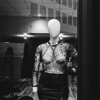 Mannequin in window by Dylan Murphy