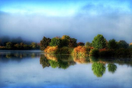 Misty fall colors on the river by Lynn Hopwood