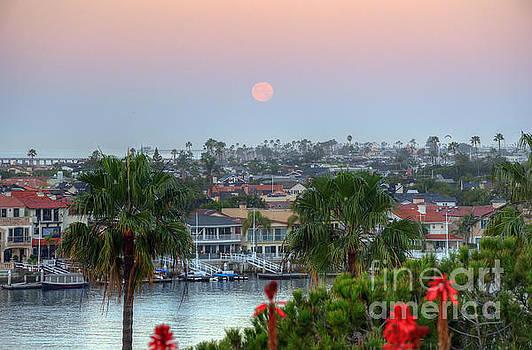 Full Moon Setting in Corona Del Mar by Eddie Yerkish