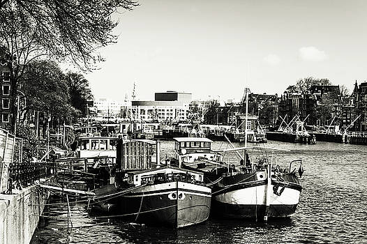 Moored Boats at Amsterdam Canal. Monochrome by Jenny Rainbow