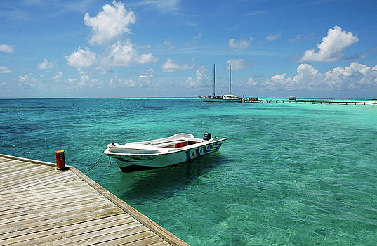 Jenny Rainbow - Moored White Boat in Blue Lagoon
