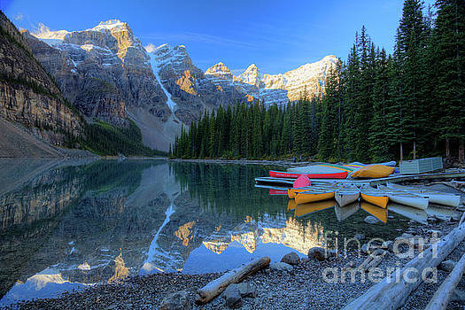 Moraine Lake Sunrise Blue Skies Canoes by Wayne Moran