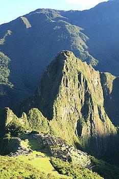 Morning shines on Machu Picchu by Roupen  Baker