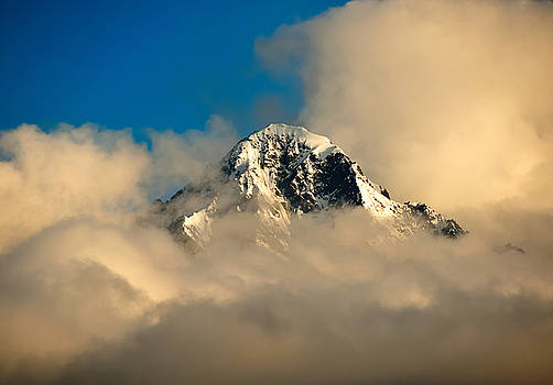 Mountain peak with cloud cover below it. by Jay Mudaliar