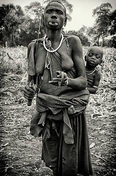 Mursi Woman and Baby by Nichon Thorstrom