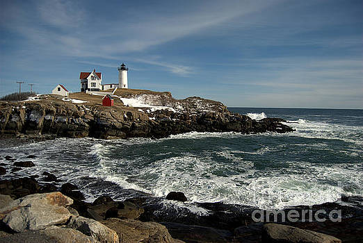 Nubble Lighthouse In Winter by Eunice Miller