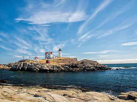 Nubble Lighthouse with Dramatic Clouds by Nancy de Flon