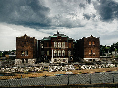 Old abandoned school and stormy skies by Dylan Murphy