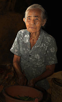Old Balinese woman by Dray Van Beeck