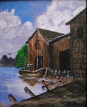 Old boat at dock by Cynthia Farmer