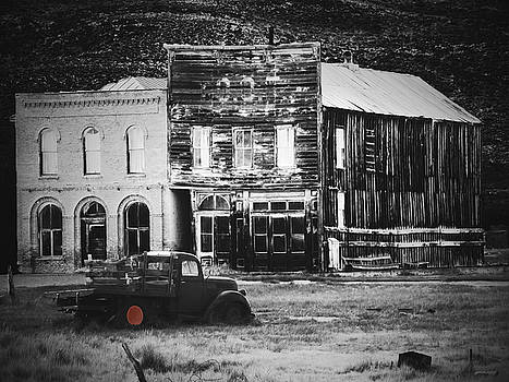 Old Buildings with Truck Black and White by Alan Socolik