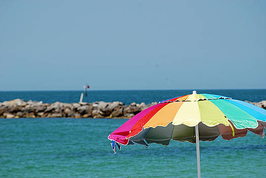 On the Rocks with an Umbrella by Peter  McIntosh