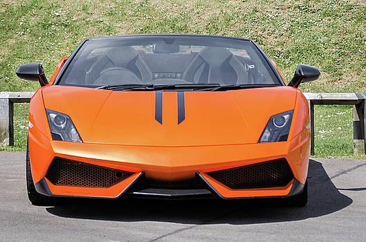 Orange supercar by Jeremy Sage