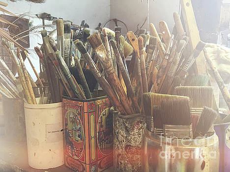 Paintbrushes in pots by Patricia Hofmeester