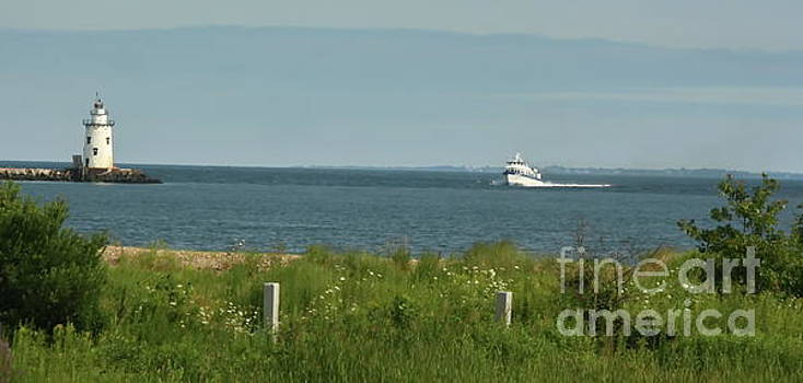 Passing the old lighthouse in Old Saybrook by Marcel  J Goetz  Sr