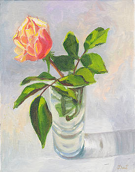 Pink and yellow rosebud in a glass vase by Dai Wynn