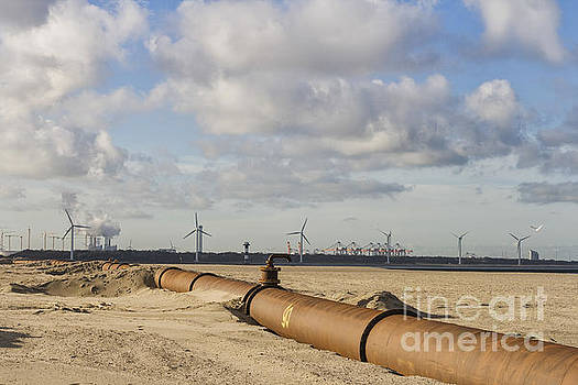 Patricia Hofmeester - Pipelines on beach near port of Rotterdam