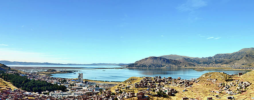 Puno city located on Titicaca lake bank by Aleksandr Volkov