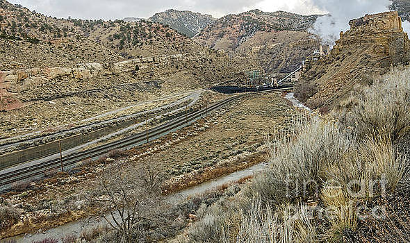 Railroad Tracks Lead to Power Plant by Sue Smith