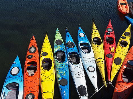 Rainbow of kayaks  by John Scates