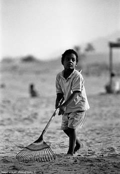 Isaac Silman - raking the sand Sinai Egypt.