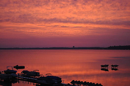 Red Sky Sunrise of Lake Michigan in Traverse City by D Keller