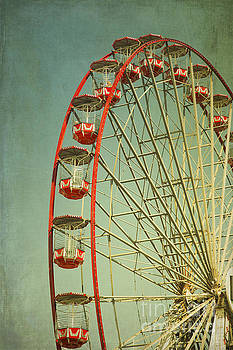 Red Vintage ferry wheel by Isabel Poulin