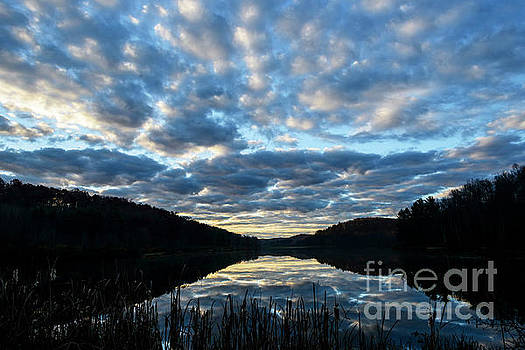Reflecting Clouds on  Lake by Thomas R Fletcher