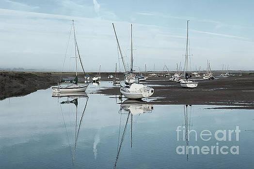 Reflections at Brancaster Staithe Norfolk by John Edwards