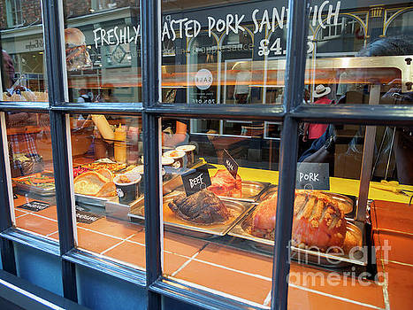 Roasted meats in a shop window in York England by Louise Heusinkveld