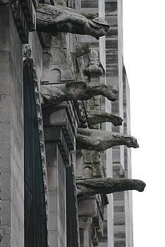Row of gargoyles by Christopher Kirby