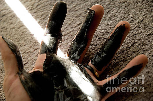 Rubber hand by Micah May