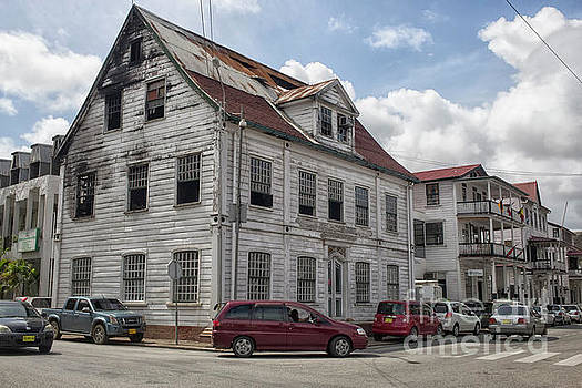 Patricia Hofmeester - Run down building with fire damage in Paramaribo