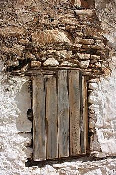 Yvonne Ayoub - Rustic Door in stone wall