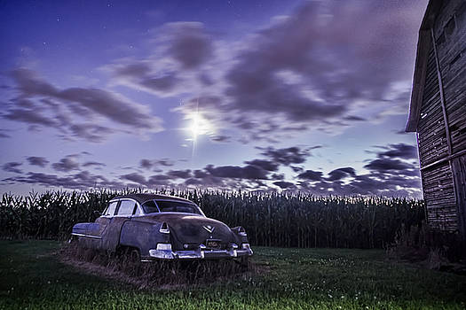 Rusty old cadillac in the moonlight by Sven Brogren