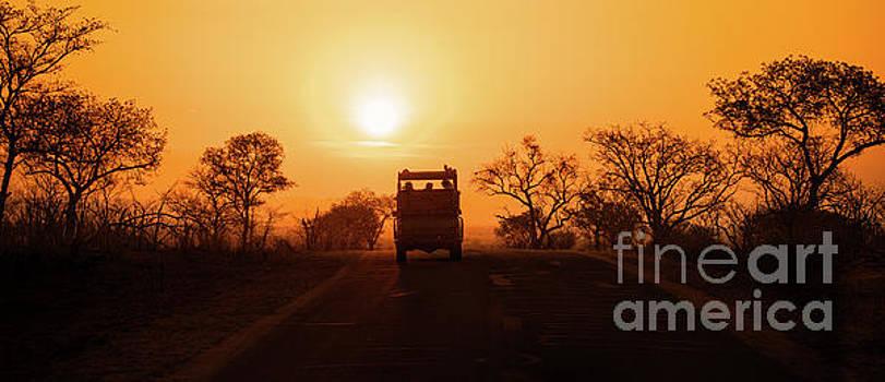 Safari vehicle at sunset by Jane Rix