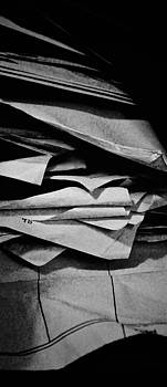 Self Portrait in a pile of paper by Brian Sereda