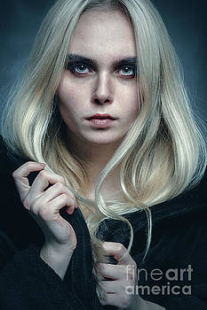 Serious Blond Girl by Aleksey Tugolukov