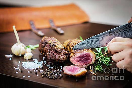 Serving Carving Roast Pork Meat Roll Meal In Rustic Style by Jacek Malipan