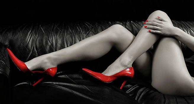 Sexy Woman Legs in Red High Heels by Oleksiy Maksymenko