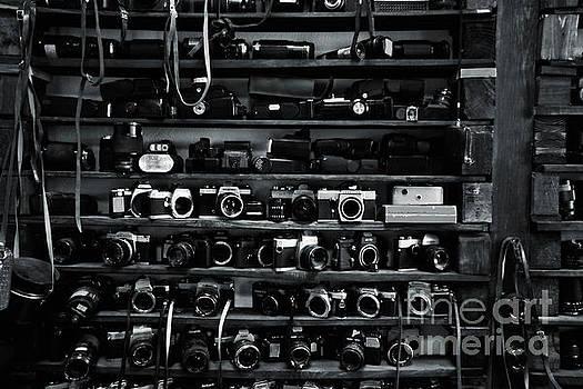 Shelf with old cameras by Magomed Magomedagaev